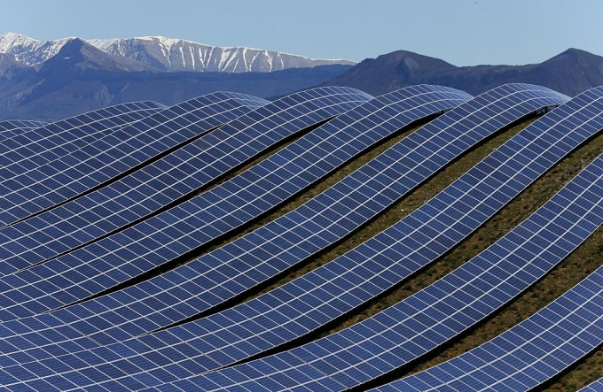 A general view shows solar panels to produce renewable energy at the photovoltaic park in Les Mees, in the department of Alpes-de-Haute-Provence, southern France March 31, 2015. REUTERS/Jean-Paul Pelissier